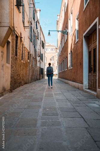 Narrow street in old town (Venice - Italy)