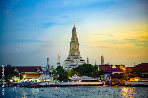 Wat Arun Temple at sunrise. view across Chao Phraya river. Landmarks of bangkok , Thailand