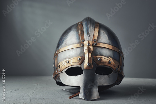 Knight's helmet on a gray background Fototapeta