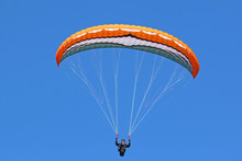 Paraglider Flying In A Blue Sky