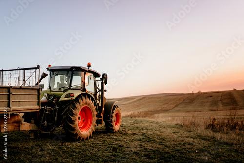 Fototapeta Farmer using modern tractor for harvesting obraz