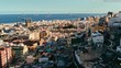 aerial drone footage of the city with beautiful seascape the old town at sunset