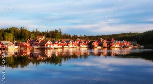 red houses at sunset in the  fishing village of Norfaellsviken, Höga Kusten, Swe Fototapete