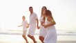 Hispanic parents in white clothing enjoying time with children by ocean