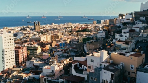Poster aerial drone footage of the city with beautiful seascape the old town at sunset