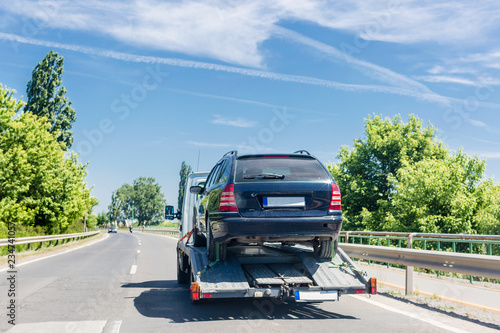 Photo  Car carrier trailer with car