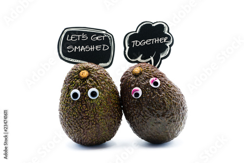 Romantic avocados couple with googly eyes and speech bubble as man and woman, funny food concept for creative projects