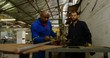 Two metalsmiths working in workshop 4k