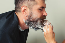 Portrait Of Male Client Getting His Beard Washed At Salon. Cleaning Beard Barber's. Man At Barbershop. Hairdresser Washing Beard To Her Handsome Client.