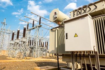Power utility box on a power transformer in substation switchyard.