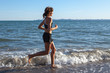 athlete running along the seashore