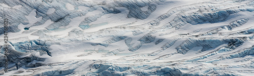 La pose en embrasure Taupe aerial ice detail of the Tunsbergdalsbreen glaciar, Norway's longest glacier arm of the Folgefonna ice cap