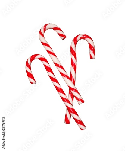 Red striped candy cane as a symbol of New year isolated.