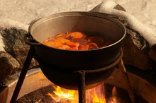 Cauldron With The Mulled Wine Cooked Over The Fire
