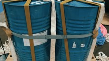 On The Wooden Pallet There Are Four Metal Barrel Tied By Strap With A Laid Parachute , Ready To Be Dropped From An Airplane. Shot In Motion