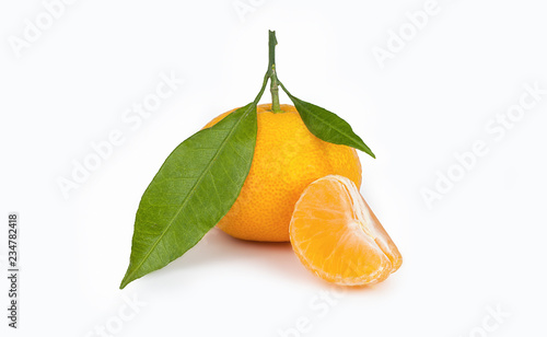 yellow sweet isolated peeled and whole mandarin clementine tangerine on white copy space with leaf. Tangerines background concept