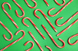 canvas print picture - Flat lay composition with tasty candy canes on color background