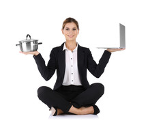 Businesswoman With Saucepan And Laptop Sitting In Lotus Position On White Background. Combining Life And Work