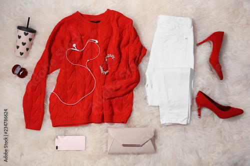 Flat lay composition with set of stylish winter outfit on fur