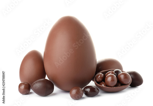Tasty chocolate Easter eggs on white background