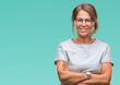 Middle age senior hispanic woman wearing glasses over isolated background happy face smiling with crossed arms looking at the camera. Positive person.