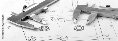 Fotografie, Obraz The old metal caliper and engineering drawing.