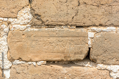 Fotobehang Chinese Muur A View of an Ancient Brick Engraved with Chinese Writing on it that is part of the Great Wall of CHINA
