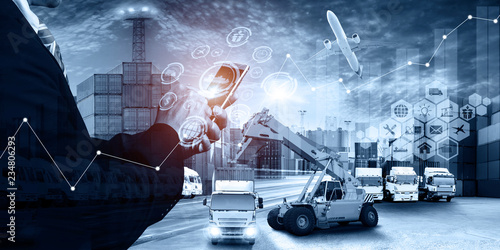 Abstract image of business man point to the hologram on smartphone and Industrial Container Cargo freight ship, forklift handling container box loading for logistic import export and transport