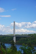 Bucksport, Maine, USA: White Clouds In A Bright Blue Sky Over The Penobscot Narrows Bridge. The Bridge Is A 2,120 Ft. Long Cable-stayed Bridge Over The Penobscot River.