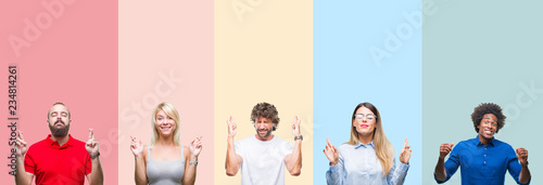 Carta da parati Collage of group of young people over colorful vintage isolated background smiling crossing fingers with hope and eyes closed