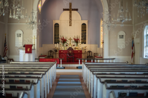 Foto Church interior with decorated altar in soft focus