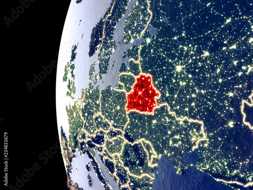 Fototapeta Night view of Belarus from space with visible city lights