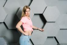 Pretty Blonde Girl, Blue Eyes In A Pink Tank Top, In Blue Jeans Posing