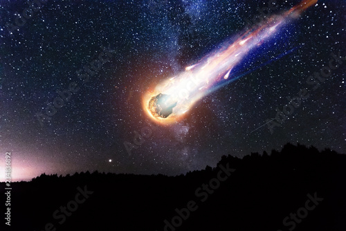 A comet, an asteroid, a meteorite falls to the ground against a starry sky Canvas Print
