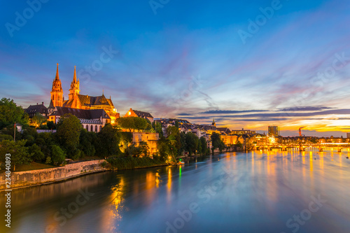 Sunset view of riverside of Rhine in Basel dominated by majestic building of Mun Wallpaper Mural