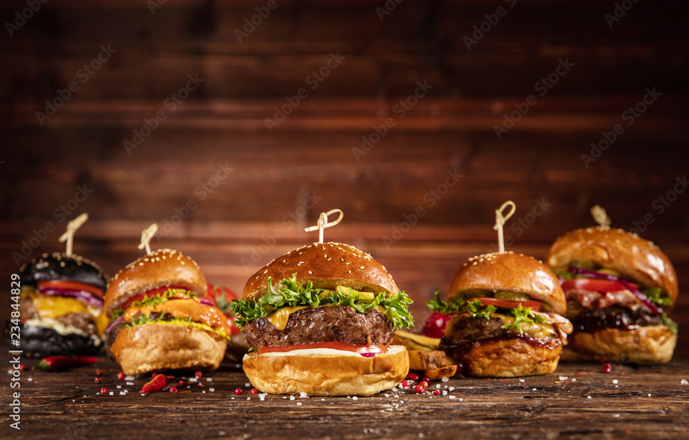 Fototapety, obrazy: Delicious hamburgers, served on wood