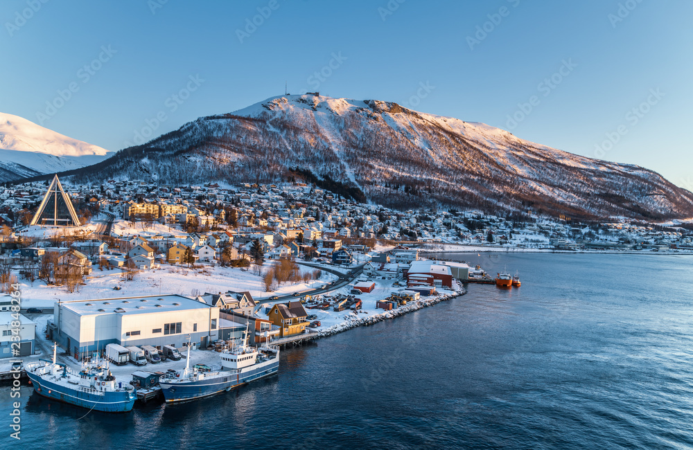 Fototapeta Aerial view to the city of Tromso and it's marina in winter, North Norway.