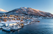 canvas print picture - Aerial view to the city of Tromso and it's marina in winter, North Norway.