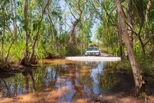 Four Wheel Drive Vehicle Fording A Creek In The Litchfield National Park, Northern Territory, Australia.