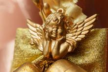 Close-up Of Golden Cherub Figu...