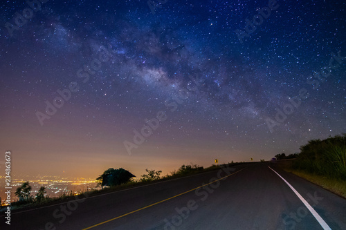 night landscape road on mountain and milky way galaxy background ,Thailand , long exposure , low light