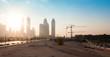 Dubai city under construction with cranes, industrial photo