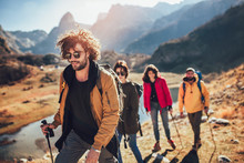 Group Of Hikers Walking On A M...