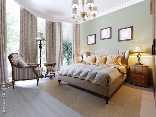 English Style Bedroom With A Large Soft Fabric Bed Bedside Tables