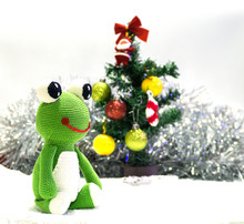 Little Green Frog Sitting On White Snow In Front Of Christmas Tree Waiting Happy Party, Happy Concept