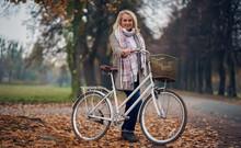 Senior Woman In Park In Autumn