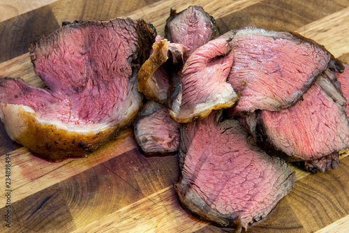 Slices of meat picanha on chopping board