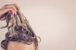 Leinwanddruck Bild - Funny woman pulls himself wet hair up. Close-up, space for text. Hair care concept