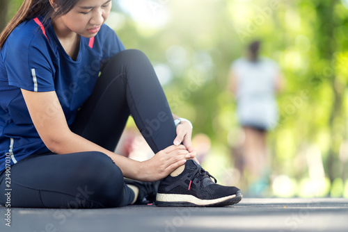 Young asian woman suffering ankle injury Canvas Print