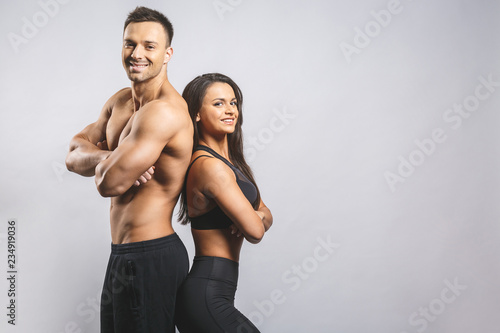 Valokuvatapetti Athletic man and woman isolated over white background